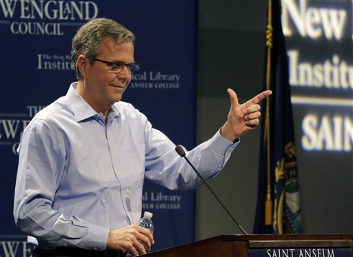 """Former Florida Gov. Jeb Bush jokes with a member of the audience at a """"Politics and Eggs"""" event, a breakfast fixture for 2016 presidential prospects, Friday, April 17, 2015, at Saint Anselm College in Manchester, N.H. (AP Photo/Elise Amendola)"""