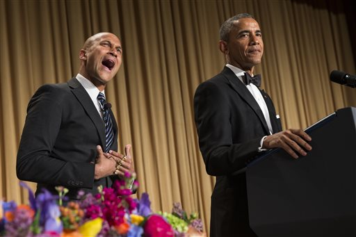 "President Barack Obama, left, brings out actor Keegan-Michael Key from Key & Peele to play the part of ""Luther, President Obama's anger translator"" during his remarks at the White House Correspondents' Association dinner at the Washington Hilton on Saturday, April 25, 2015, in Washington. (AP Photo/Evan Vucci)"