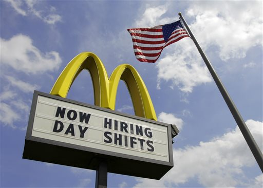This May 2, 2012, file photo shows a sign advertising job openings outside a McDonalds restaurant in Chesterland, Ohio. McDonald's on Wednesday, April 1, 2015 said it's raising pay for workers at its company-owned U.S. restaurants, making it the latest employer to sweeten worker incentives in an improving economy. (AP Photo/Amy Sancetta, File)