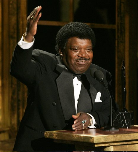 "In this March 14, 2005 file photo, Percy Sledge accepts his award during the Rock and Roll Hall of Fame induction ceremony in New York. Sledge was remembered for phenomenal talent and extraordinary kindness during a funeral service on Tuesday, April 21, 2015, in Baker, La. Sledge, who recorded the classic 1966 soul ballad ""When a Man Loves a Woman,"" died, April 14, at the age of 74. (AP Photo/Julie Jacobson, File)"