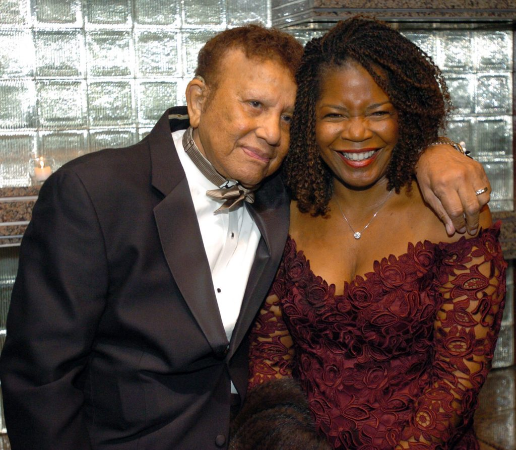 Hal Jackson and wife Debi share a moment before celebrating Jackson's  65 years of broadcasting at a benefit for the Youth Development Foundation, Wednesday, November 3, 2004, at the Rainbow Room in New York. (AP Photo/Gina Gayle)