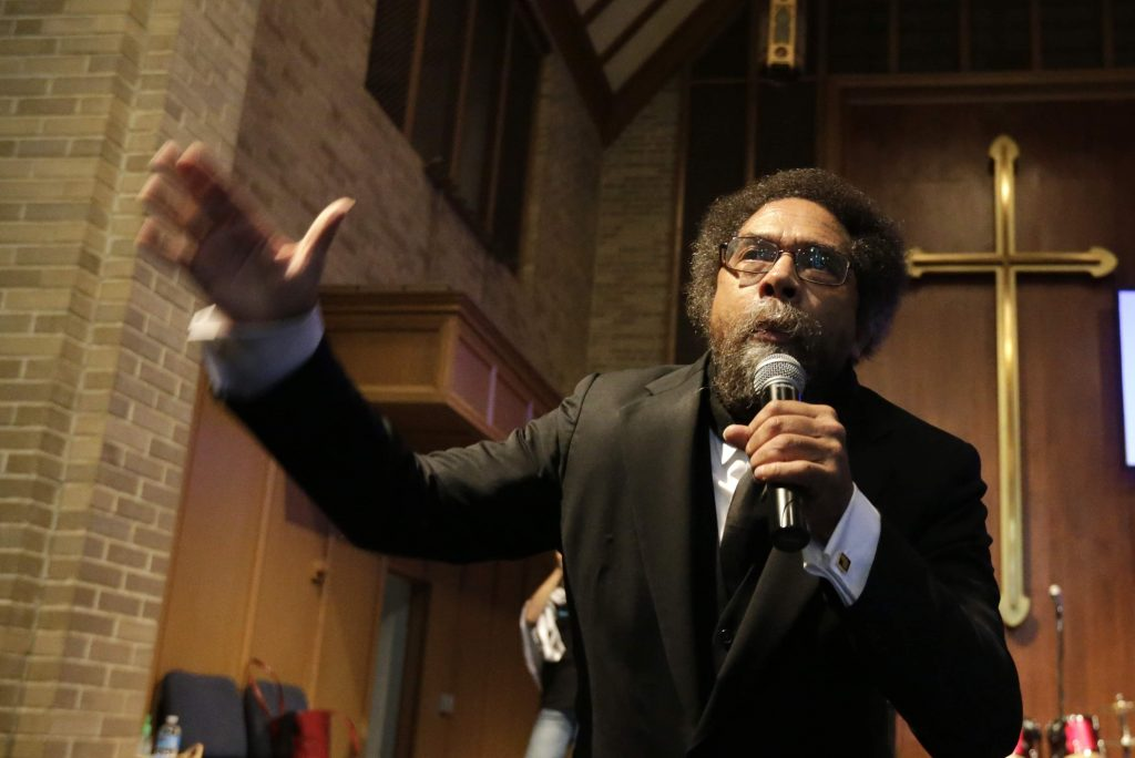 Cornel West talks to protesters before a march to the Ferguson, Mo. police station. Activists planned a day of civil disobedience to protest the shooting of Michael Brown in August and a second police shooting in St. Louis, October 2014. (AP Photo)