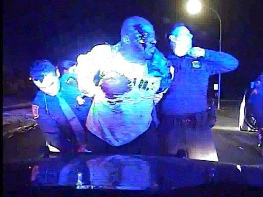 In this still from a police dash-cam video, a bloodied Floyd Dent is seen after being beaten and tasered during a traffic stop in January. Dent was reportedly protecting himself from being beaten and choked when he was arrested by Inkster police (Inkster Police Department)