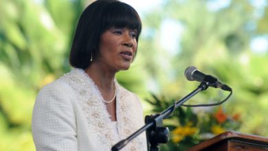 Photo of Jamaica's Prime Minister May Request Exoneration of Garvey When She Meets President Obama in Kingston
