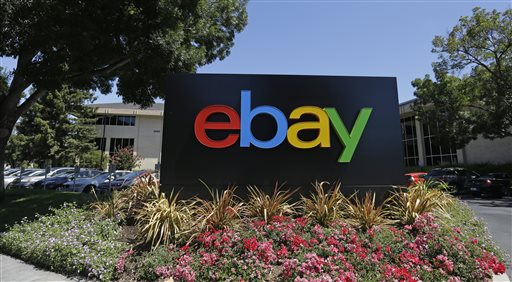 """This July 16, 2013 file photo shows an eBay sign at eBay headquarters in San Jose, Calif. EBay plans to grow by thinking small as it prepares for life apart from PayPal. CEO John Donahoe said Wednesday, April 22, 2015, the company says it is moving toward the spinoff with """"clarity and speed."""" (AP Photo/Ben Margot, File)"""