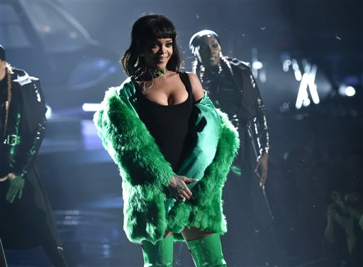 In this Sunday, March 29, 2015 file photo, Rihanna performs on stage at the iHeartRadio Music Awards at The Shrine Auditorium in Los Angeles. Madonna, Rihanna, Beyonce and Jay Z are among the A-List musicians who are co-owners of the streaming service Tidal. Kanye West, Daft Punk, Alicia Keys, Jack White and Nicki Minaj also announced that they are co-owners of the streaming service at an event Monday, March 30, 2015, in New York City.  (AP Photo/iHeartRadio, John Shearer, File)