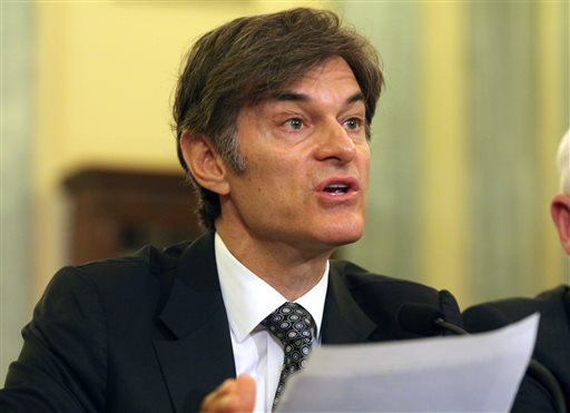 """In this June 17, 2014, file photo, Dr. Mehmet Oz, vice chairman and professor of surgery, Columbia University College of Physicians and Surgeons, testifies on Capitol Hill in Washington. Oz is fighting back against critics who are trying to get him removed from a faculty position at Columbia University. Dr. Mehmet Oz will air an episode of his syndicated talk show on Thursday that specifically takes on the group of 10 doctors from around the country who wrote to a Columbia dean about him. The group suggested last week that Oz promotes """"quack treatments"""" of weight loss supplements with no scientific proof that they work. (AP Photo/Lauren Victoria Burke, File)"""