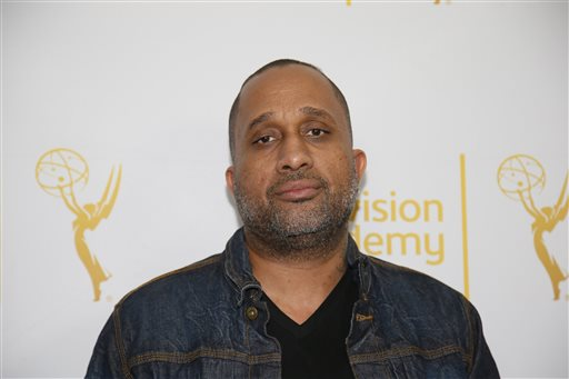 "In this Jan. 28, 2015 file photo, Creator and Executive producer of ""Black-ish,"" Kenya Barris, poses on the red carpet at ""An Evening with Norman Lear,"" presented by the Television Academy at the Montalban Theatre in the Hollywood section of Los Angeles. Barris is set to write the screenplay for a ""Good Times"" film based on the hit '70s sitcom, his manager confirmed Monday, April 26, 2015, to The Associated Press. ""Good Times,"" which aired on CBS from 1974 to 1979, was about an African-American family living in a poor neighborhood in Chicago. (Danny Moloshok/Television Academy via AP, File)"