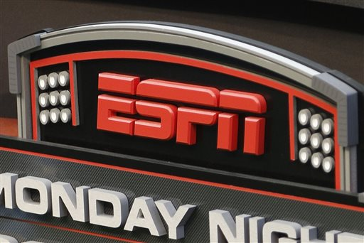 This Sept. 16, 2013 photo shows the ESPN logo prior to an NFL football game between the Cincinnati Bengals and the Pittsburgh Steelers, in Cincinnati. ESPN on Monday, April 27, 2015 filed a lawsuit against Verizon in an escalating clash over how the popular sports channel is being sold in a discounted pay-TV package. (AP Photo/David Kohl)
