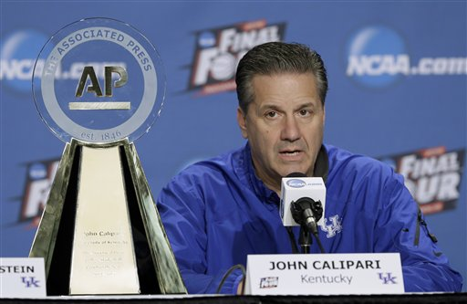 Kentucky head coach John Calipari sits by his AP College Basketball Coach of the Year trophy during a news conference for the NCAA Final Four tournament college basketball semifinal game Friday, April 3, 2015, in Indianapolis. Kentucky plays Wisconsin on Saturday. (AP Photo/Charlie Neibergall)