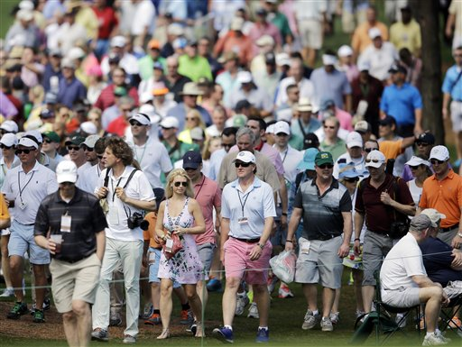 Spectators walk along the seventh fairway during a practice round for the Masters golf tournament Wednesday, April 8, 2015, in Augusta, Ga. (AP Photo/Matt Slocum)