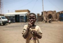 Photo of In Sudan, Poverty, Heavy Security Grip Under Longtime Leader