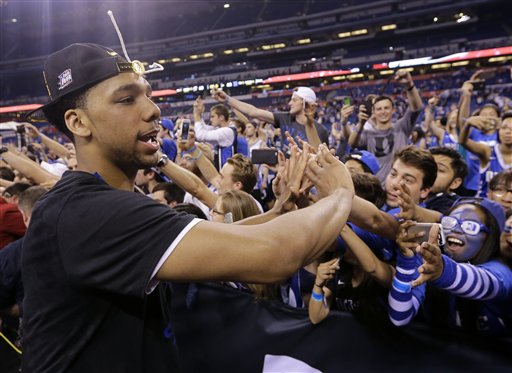 Duke's Jahlil Okafor celebrates with fans after his team's 68-63 victory over Wisconsin in the NCAA Final Four college basketball tournament championship game Monday, April 6, 2015, in Indianapolis. (AP Photo/David J. Phillip)