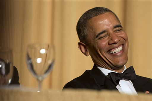 "In this May 3, 2014 file photo, President Barack Obama laughs as actor and comedian Joel McHale speaks during the White House Correspondents' Association (WHCA) Dinner at the Washington Hilton Hotel in Washington. A former Politico journalist is poking a hole in the bubble that surrounds one of Washington's biggest, celebrity-obsessed weekends with his new documentary ""Nerd Prom."" The official dinner draws the president to the stage to make some jokes, and many attendees spend the night posing for selfies with celebrity guests. This year's dinner is set for Saturday. Film producers plan to release ""Nerd Prom"" on iTunes, Amazon and Netflix in the coming months. (AP Photo/Jacquelyn Martin, File)"