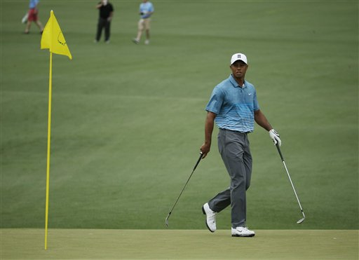 Tiger Woods walks on the second green during a practice round for the Masters golf tournament Monday, April 6, 2015, in Augusta, Ga. (AP Photo/Charlie Riedel)