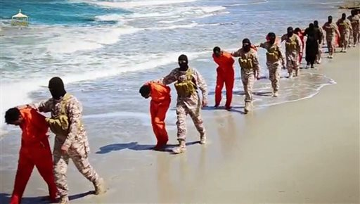 This undated image made from a video released by Islamic State militants, Sunday, April 19, 2015, shows a group of captured Ethiopian Christians taken to a beach before they were killed by Islamic State militants, in Libya.  The 29-minute video released online Sunday purportedly shows two groups of captives. It says one group is held by an IS affiliate in eastern Libya and the other by an affiliate in the south. A masked fighter delivers a long statement before the video switches between footage that purportedly shows the captives in the south being shot dead and the captives in the east being beheaded on a beach. (Militant video via AP)