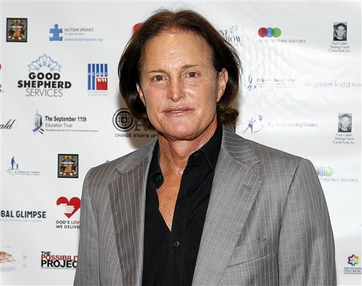 In this Sept. 11, 2013 file photo, former Olympic athlete Bruce Jenner arrives at the Annual Charity Day hosted by Cantor Fitzgerald and BGC Partners, in New York. ABC 's Diane Sawyer will interview the former Olympic champion and patriarch of the Kardashian television clan in a two-hour interview airing on Friday, April 24. (Photo by Mark Von Holden/Invision/AP, File)