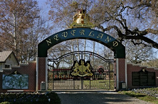 This Dec. 2004 file photo shows, the entrance to pop star Michael Jackson's Neverland Ranch in Santa Ynez, Calif.  Neverland is going up for sale. The Santa Ynez Valley property that once served as the late pop star's home and personal fantasyland is being listed for sale at $100 million, according to the Wall Street Journal on Thursday, May 28, 2015. (AP Photo/Mark J. Terrill, File)