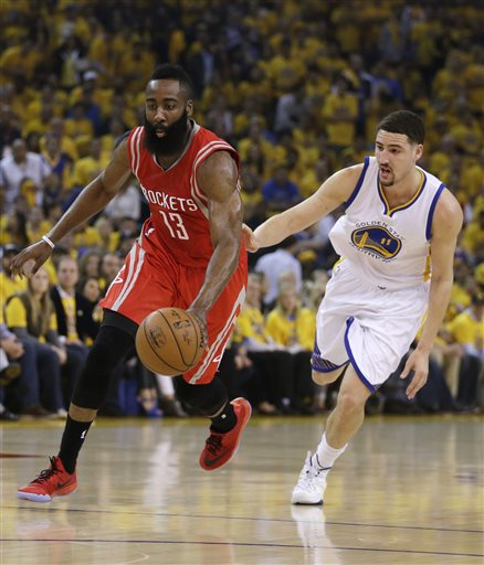 Houston Rockets' James Harden, left, drives the ball past Golden State Warriors' Klay Thompson (11) during the first quarter of Game 1 of the NBA basketball Western Conference finals Tuesday, May 19, 2015, in Oakland, Calif. (AP Photo/Ben Margot)