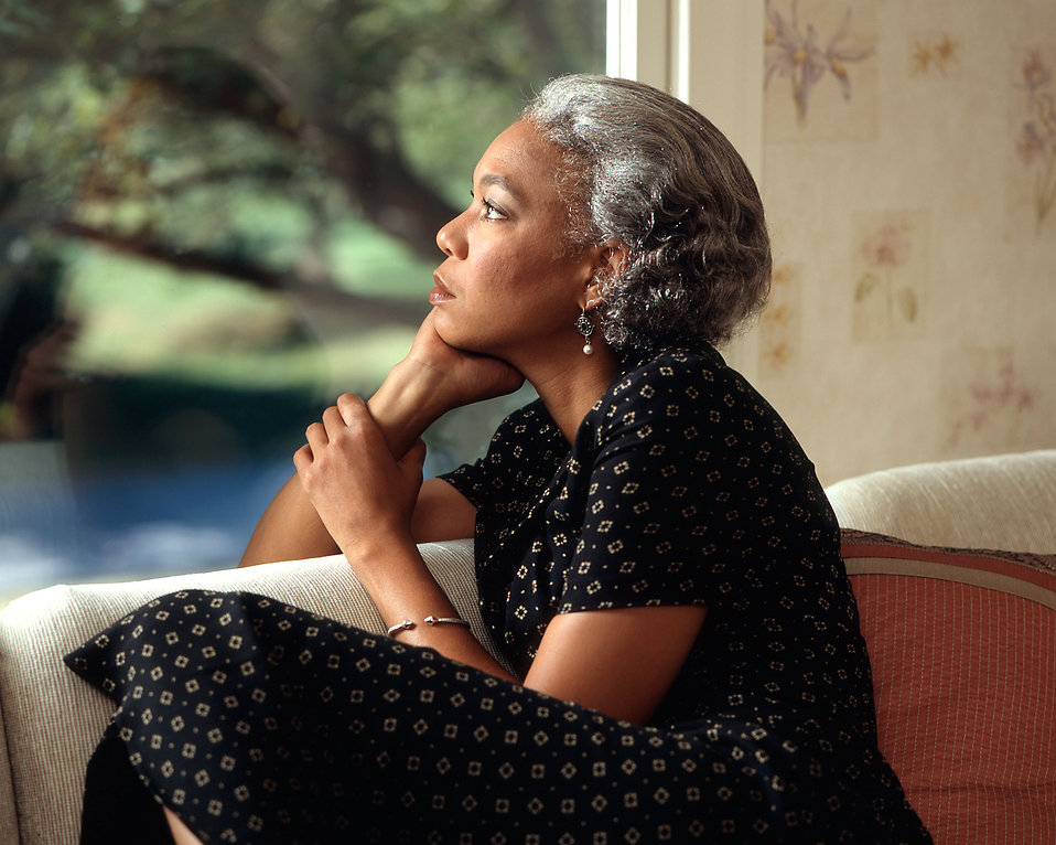 17075-an-african-american-woman-looking-out-a-window-pv