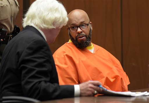 """Marion """"Suge"""" Knight appears in court during his arraignment on murder charges with his attorney Thomas Mesereau in Los Angeles Friday, May 29, 2015. A motion to dismiss the murder case against Knight is being delayed because the former rap music mogul has changed attorneys. Knight's new attorney  Thomas Mesereau, who successfully defended Michael Jackson against molestation allegations. (Frederic J. Brown/Pool Photo via AP)"""