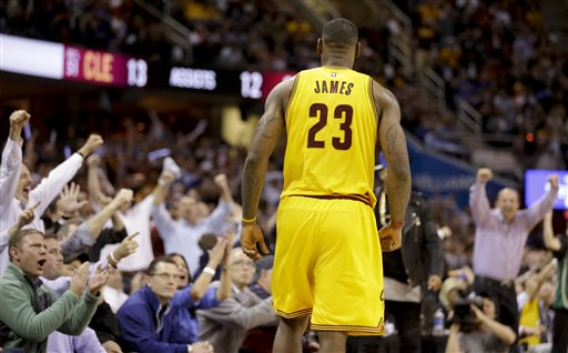 Spectators cheer Cleveland Cavaliers forward LeBron James (23) after James scored against the Chicago Bulls during the second half of Game 5 in a second-round NBA basketball playoff series Tuesday, May 12, 2015, in Cleveland. (AP Photo/Tony Dejak)