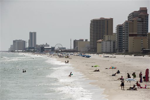 In this Wednesday, May 13, 2015 photo, tourists line the beaches in Gulf Shores, Ala. Industry officials say Gulf Coast tourism is surging, five years after the BP oil spill. (AP Photo/Brynn Anderson)