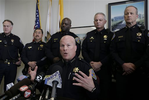 In this Feb. 27, 2014 file photo, San Francisco Police Chief Greg Suhr speaks during a news conference at the Hall of Justice in San Francisco. The original charges were shocking enough: six San Francisco police officers were accused of stealing from suspects living in seedy residential hotels. Then federal prosecutors released racist, homophobic and ethnically insensitive email and text messages exchanged among more than a dozen officers, prompting the San Francisco district attorney to launch a wide-ranging investigation of the police department while considering dismissing up to 3,000 criminal cases involving the officers. (AP Photo/Jeff Chiu, File)