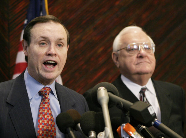 Dan K. Webb (left), attorney for former Illinois Gov. George Ryan (right), speaks to the media during a news conference in 2003. Webb represented Ryan on racketeering and corruption charges. Webb is now representing Ferguson in the Department of Justice case against the city. (AP Photo/Brian Kersey)