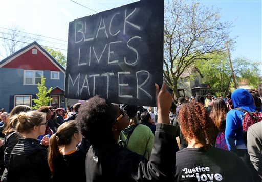 Supporters participate in a during a demonstration for Tony Robinson along Williamson Street in Madison, Wis., Wednesday, May 13, 2015. Dane County District Attorney Ismael Ozanne said Tuesday, May 12, that he wouldn't file charges against Madison Officer Matt Kenny in the March 6 death of Robinson, saying the officer used lawful deadly force after he was staggered by a punch to the head and feared for his life. (John Hart/Wisconsin State Journal via AP)