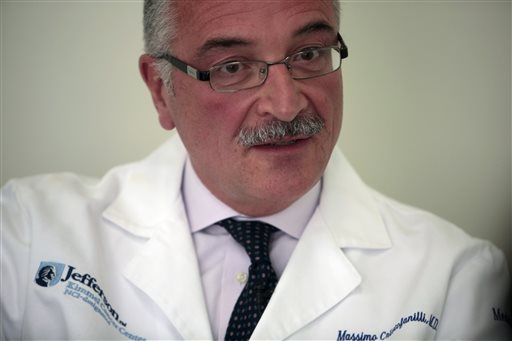 """Dr. Massimo Cristofanilli, oncologist and director of the Breast Care Center, speaks during an interview at Jefferson University Hospital in Philadelphia on Tuesday, April 28, 2015. With a tissue biopsy, """"our treatments lag behind and they're still based on limited information,"""" Cristofanilli says. With a liquid biopsy, """"the power of this test has been to really find out how the disease changes, even in a short period of time."""" (AP Photo/Jacqueline Larma)"""