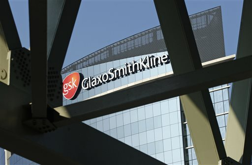 This April 20, 2009 file photo shows signage at the offices of pharmaceuticals firm GlaxoSmithKline, in London. GlaxoSmithKline on Wednesday, May 6, 2015 opted to keep its stake in its stand-alone HIV business as it set out its strategy following a big deal with Switzerland's Novartis. (AP Photo/Sang Tan, File)