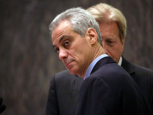 Chicago Mayor Rahm Emanuel, left, with corporation counsel Steve Patton by his side, presides over the Chicago City Council for the first time after being re-elected mayor, Wednesday, April 15, 2015, in Chicago. The Chicago City Council has approved a $5 million settlement with the family of a teenager who died after being shot by a police officer 16 times last October. (Nancy Stone/AP Photo)