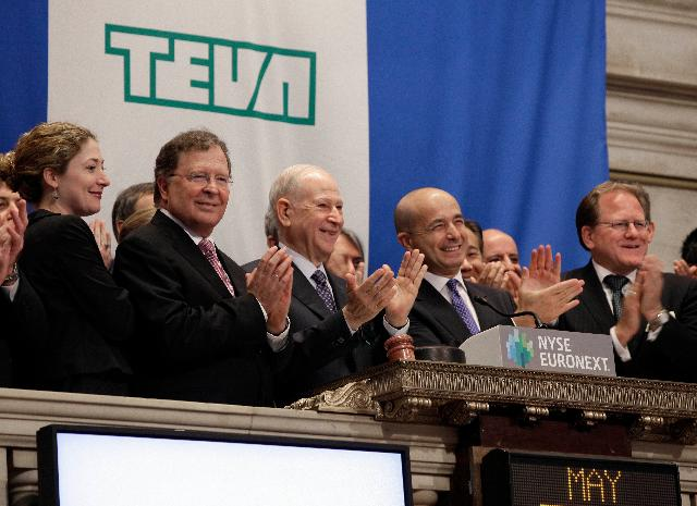 Teva Pharmaceuticals CFO Eyal Desheh, second left, Chairman Dr. Phillip Frost, third left, and CEO Jeremy Levin, fourth left, applaud during opening bell ceremonies of the New York Stock Exchange Wednesday, May 30, 2012. The Israeli company said last week it expects weaker sales of generic drugs, which bring in most of its revenue, and of brand-name products, which has become a priority for Teva in recent years and drove its recent $6.8 billion acquisition of Cephalon Inc. (AP Photo/Richard Drew)