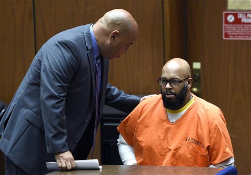 "In this March 9, 2015 file photo, attorney Mathew Fletcher, left, talks with his client Marion ""Suge"" Knight upon his arrival  in court for a hearing about evidence in his murder case, in Los Angeles, Calif.  Knight is scheduled to return to a Los Angeles courtroom on Thursday, April 30, 2015, for re-arraignment in a murder case filed after he ran over two men, killing one, in late January. Knight has previously pleaded not guilty in the case, but must be re-arraigned because a judge determined earlier this month that there is enough evidence for him to stand trial. (AP Photo/Kevork Djansezian, Pool, File)"