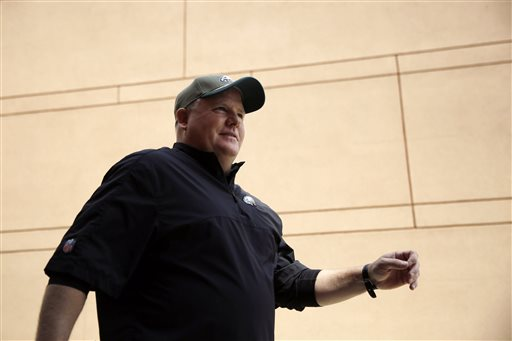 Philadelphia Eagles head coach Chip Kelly walks to a news conference before organized team activities at the NFL football team's practice facility, Thursday, May 28, 2015, in Philadelphia. (AP Photo/Matt Slocum)