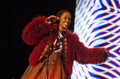 "In this Nov. 1, 2014 file photo, Lauryn Hill performs at the Voodoo Music Experience in New Orleans. Hill is canceling a planned performance in Tel Aviv because she wasn't able to schedule a concert in the Palestinian city of Ramallah. The singer-songwriter said in a statement Monday, May 4, 2015, that she originally intended to perform in both cities in hopes of being ""a presence supporting justice and peace.""  (Photo by Barry Brecheisen/Invision/AP, File)"