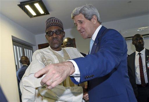 U.S. Secretary of State John Kerry, right, talks with newly inaugurated Nigerian President Muhammadu Buhari, before the start of a formal meeting near Eagle Square in Abuja, Nigeria, Friday, May 29, 2015. (AP Photo/Susan Walsh, Pool)
