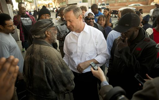 Former Maryland Gov. Martin O'Malley, center, meets with residents Tuesday, April 28, 2015, in Baltimore. Baltimore was a city on edge Tuesday as hundreds of National Guardsmen patrolled the streets against unrest for the first time since 1968, hoping to prevent another outbreak of rioting. (AP Photo/Matt Rourke)
