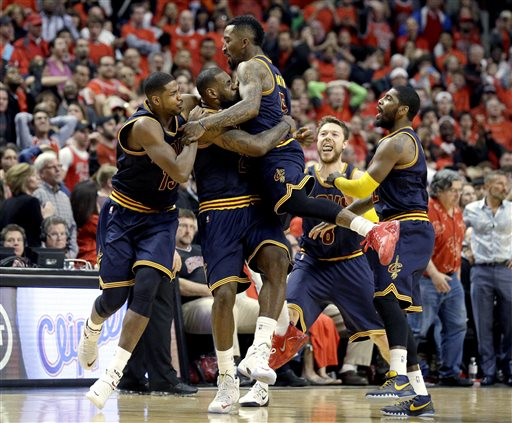 Cleveland Cavaliers' LeBron James, second from left, celebrates with Tristan Thompson, left, J.R. Smith, center, Matthew Dellavedova, and Kyrie Irving, right, after scoring the game-winning basket during the second half of Game 4 in a second-round NBA basketball playoff series against the Chicago Bulls in Chicago on Sunday, May 10, 2015. The Cavaliers won 86-84. (AP Photo/Nam Y. Huh)