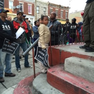 Photo of Activists Take To Streets As Baltimore Records 100th Homicide of Year