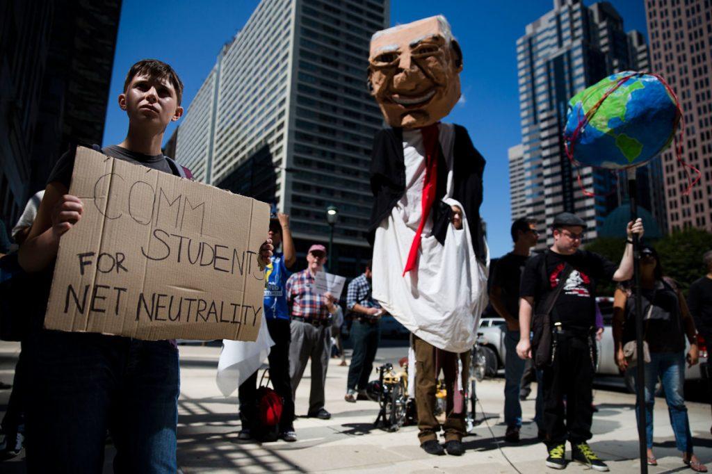 Protesters demonstrate against the proposed Comcast-Time Warner merger, in Philadelphia, in September 2014. (Matt Rourke/AP Photo)