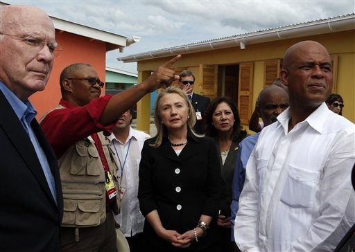 Secretary of State Hillary Rodham Clinton, center, accompanied by, from left, Sen. Patrick Leahy, D-Vt.,  Caracol Ekam Housing site engineer Mario Nicoleau, Labor Secretary Hilda Solis and Haitian President Michel Martelly, tours the Caracol Ekam Housing Site in Caracol, Haiti, Monday, Oct. 22, 2012. Clinton, and husband, former President Bill Clinton, arrived in northern Haiti Monday leading a delegation of foreign investors and a crowd of celebrities to showcase the centerpiece of the U.S. effort to help the country recover from the 2010 earthquake. (AP Photo/Larry Downing, Pool)
