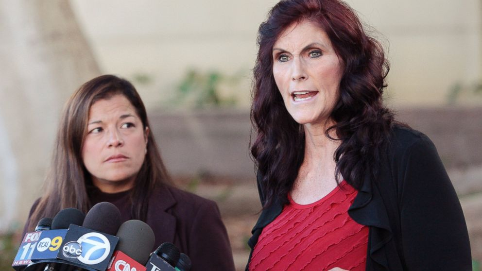 "In this Thursday, Sept. 20, 2012, file photo, Cindy Lee Garcia, one of the actresses in ""Innocence of Muslims,"" right, and attorney M. Cris Armenta hold a news conference in Los Angeles asking a judge to issue an injunction demanding a 14-minute trailer for the film be pulled from YouTube. A federal appeals court on Monday, May 18, 2015 overturned an order for YouTube to take down the anti-Muslim film that sparked violence in the Middle East and death threats to actors. (AP Photo/Jason Redmond, File)"