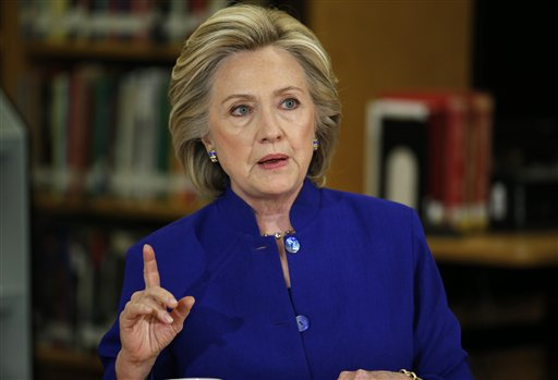 In this May 5, 2015, photo, Democratic presidential candidate Hillary Rodham Clinton speaks on immigration at an event at Rancho High School in Las Vegas. To judge them solely by their travels over the past month, you might think Jeb Bush has already plunged into the general election and Clinton has a serious fight on her hands for the Democratic nomination.  (AP Photo/John Locher)