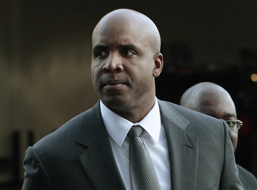FILE - In this March 29, 2011, file photo, former baseball player Barry Bonds arrives for his trial at federal court in San Francisco.  Federal prosecutors Tuesday April 28, 2015, are considering whether to ask the U.S. Supreme Court to reinstate Barry Bonds' obstruction of justice conviction. (AP Photo/Jeff Chiu)