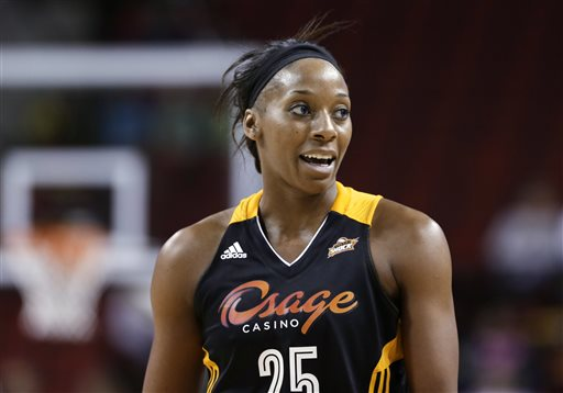 In this May 17, 2013, file photo, Tulsa Shock's Glory Johnson pauses during the team's preseason WNBA basketball game against the Seattle Storm in Seattle. Johnson had no idea her fight with Brittney Griner would become such a big deal. (AP Photo/Elaine Thompson, File)