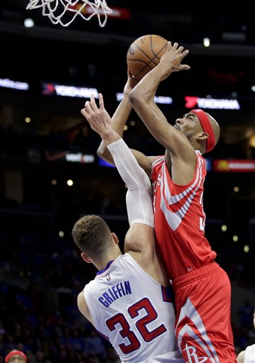 Houston Rockets guard Corey Brewer, right, shoots over Los Angeles Clippers forward Blake Griffin during the second half of Game 6 in a second-round NBA basketball playoff series in Los Angeles, Thursday, May 14, 2015. (AP Photo/Jae C. Hong)
