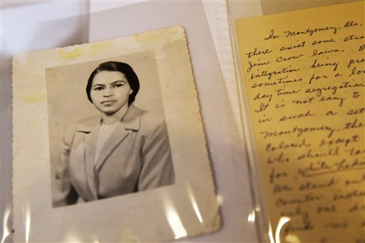 In this Jan. 29, 2015 shows a photograph of Rosa Parks circa the 1950's and a paper written by Parks about segregation are some of the items in the Rosa Parks archive, seen during a media preview at the Library of Congress, Madison Building in Washington. The family of civil rights activist Rosa Parks is thankful her memorabilia and personal items finally have a safe home. The items are on loan to the Library of Congress. They were purchased last year by a charitable foundation run by Howard Buffett, son of billionaire investor Warren Buffett. (AP Photo/Jacquelyn Martin, File)