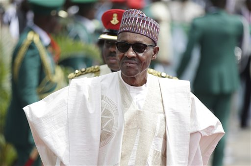 Former General and Nigerian President, Muhammadu Buhari, arrives for his Inauguration at the eagle square in Abuja, Nigeria, Friday, May 29, 2015. Nigerians celebrated their newly reinforced democracy Friday, dancing and singing songs at the inauguration of Muhammadu Buhari, the first candidate to beat a sitting president at the polls. (AP Photo/Sunday Alamba)